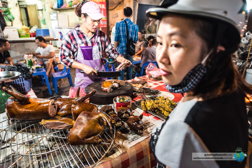 A local buying dog meat from a street seller
